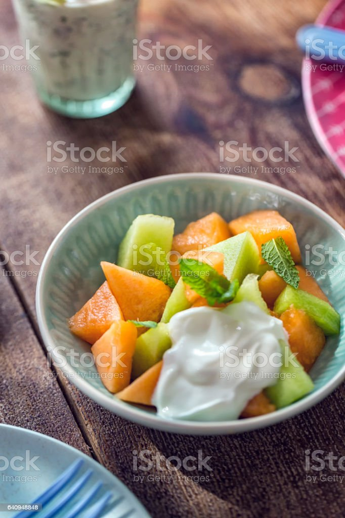Honeydew and Cantaloupe Melon with Yogurt stock photo