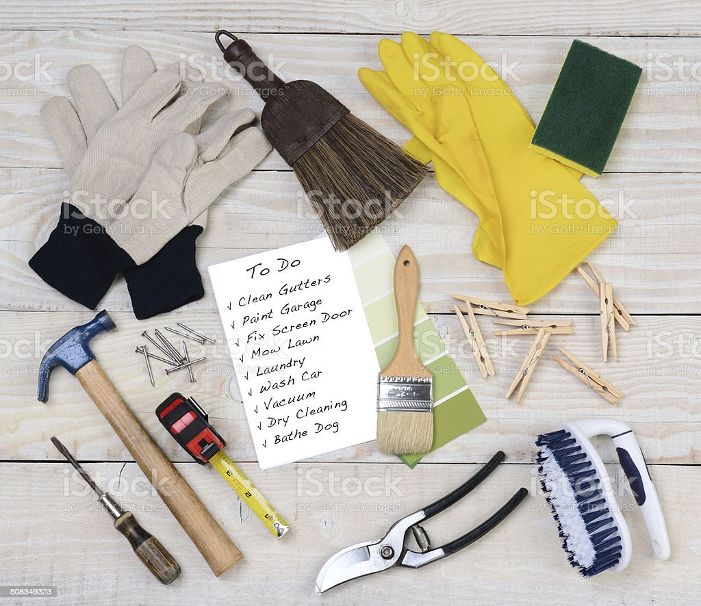 A Honey-Do List surrounded by the tools necessary to do the jobs....