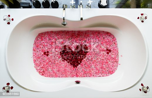 Honeymoon bathtub with red rose flower heart. romantic bathroom