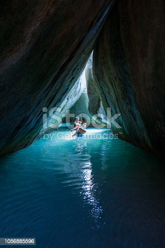 Honeymoon couple embracing in the cave at the Baths, Virgin Gorda, British Virgin Islands
