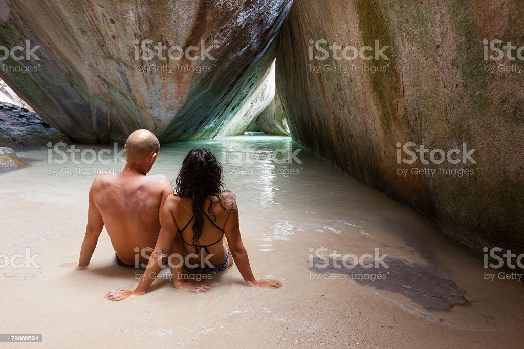honeymoon couple in a cave, The Baths, Virgin Gorda, BVI stock photo