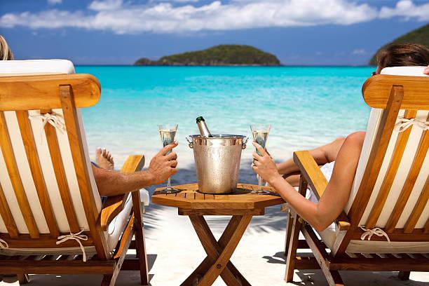 Honeymoon couple in recliners drinking champagne at a caribbean beach picture id155419403?b=1&k=6&m=155419403&s=612x612&w=0&h=khltpbh63bw5nk 2ty 1 wglleacnra z7 txlmc5kk=