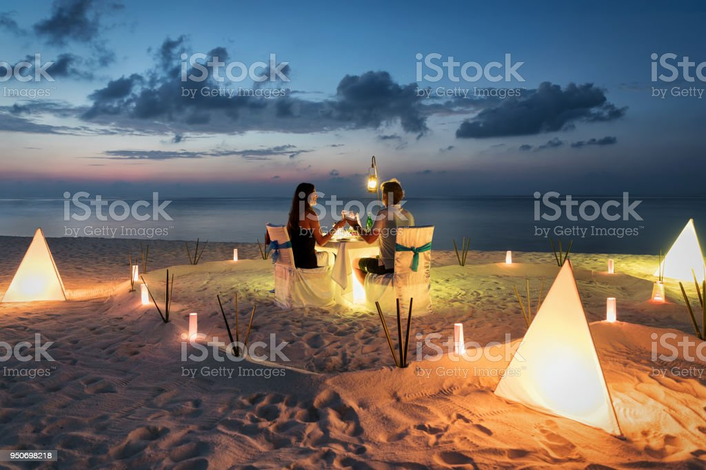Honeymoon couple is having a private, romantic dinner royalty-free stock photo