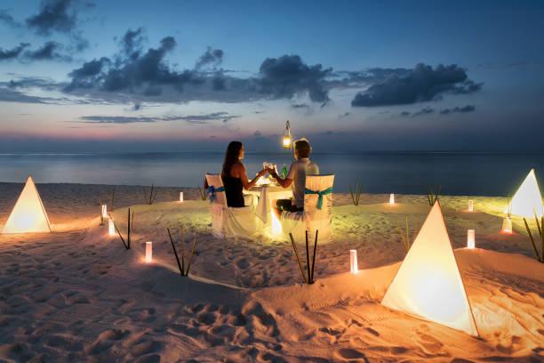 Honeymoon couple is having a private romantic dinner picture id950698218?b=1&k=6&m=950698218&s=612x612&w=0&h=sudoghmopb7wpq81nv8dpmwikcqldkl5focs2zeyebc=