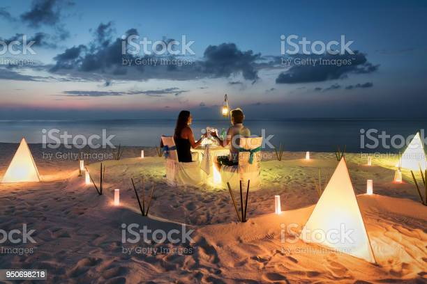 Photo of Honeymoon couple is having a private, romantic dinner