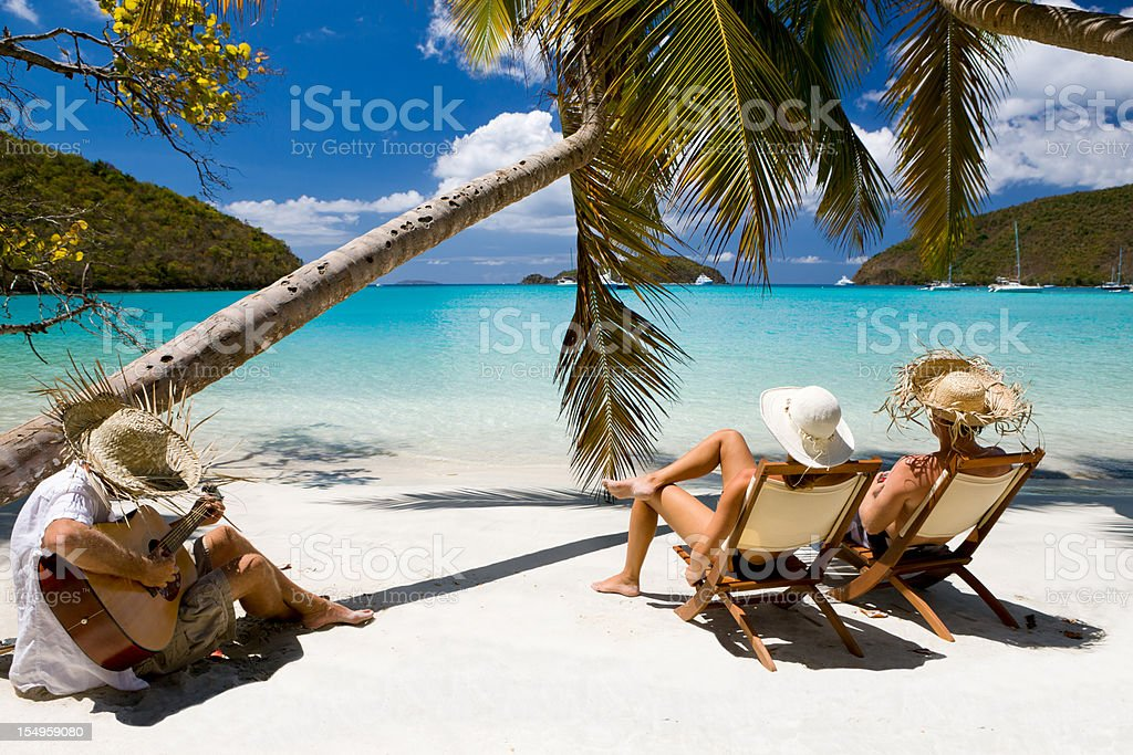 honeymoon couple relaxing at a beach in the Caribbean stock photo