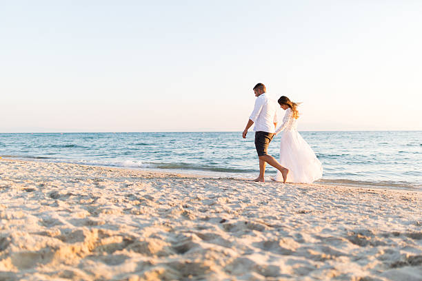 Honeymoon of just married couple stock photo