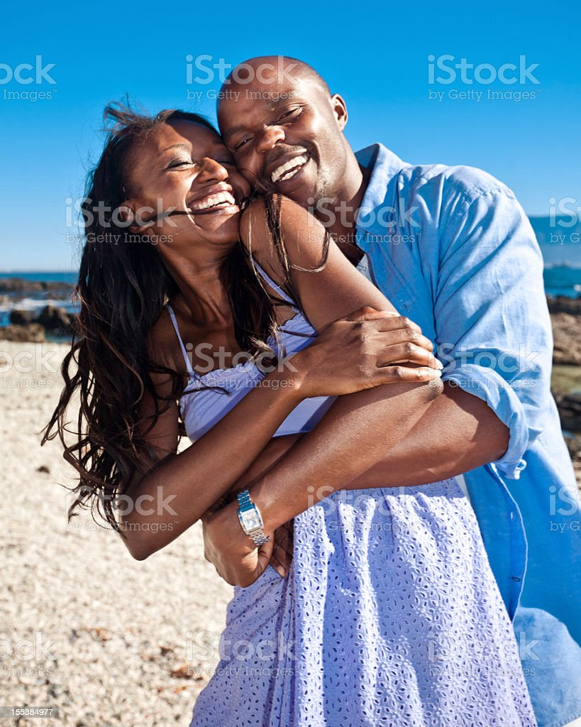 Honeymoon Romantic african american couple enjoying their summer vacation. Adult Stock Photo