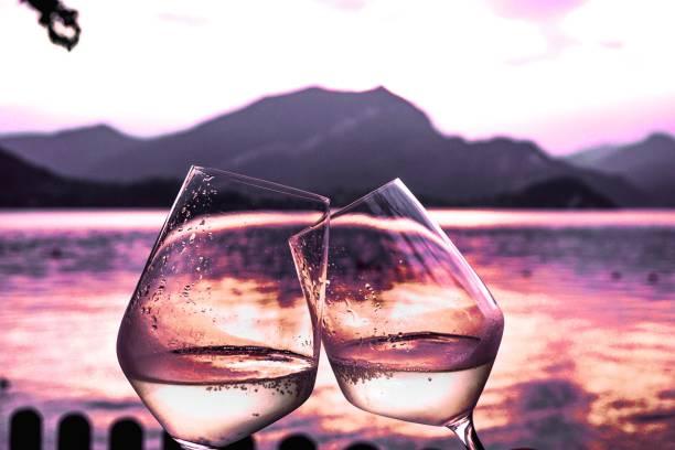 Honeymoon toast at sunset on lake Como stock photo