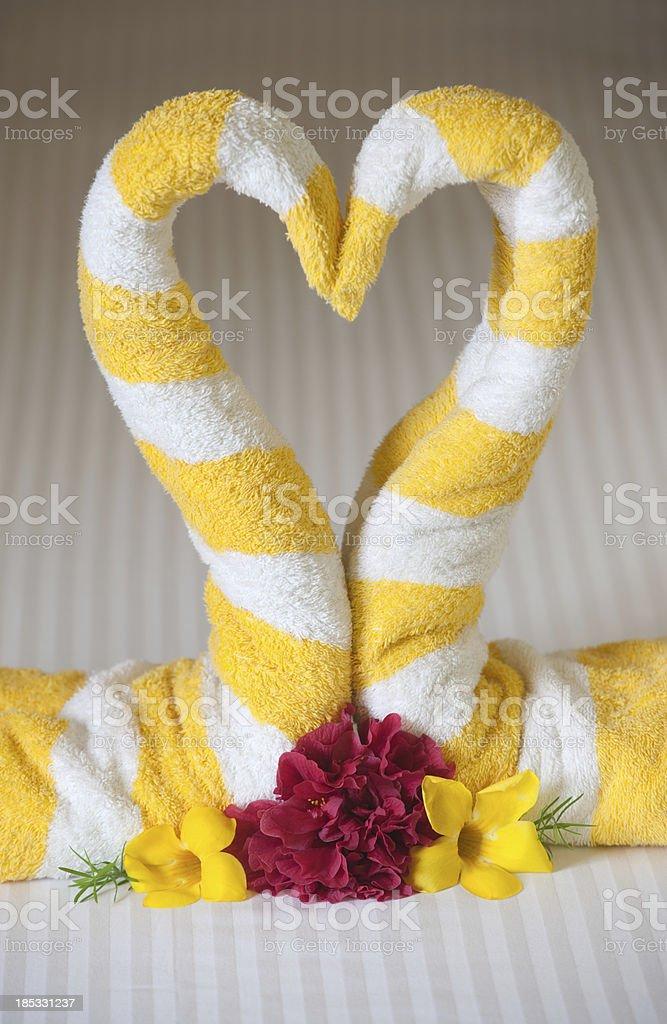 Honeymoon Towel Swan Heart on the Bed (XXXL) royalty-free stock photo