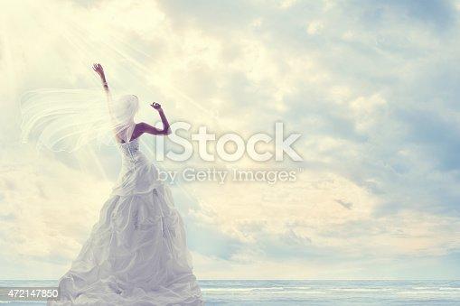 istock Honeymoon Trip, Bride Wedding Dress, Blue Sky, Romantic Travel Concept 472147850