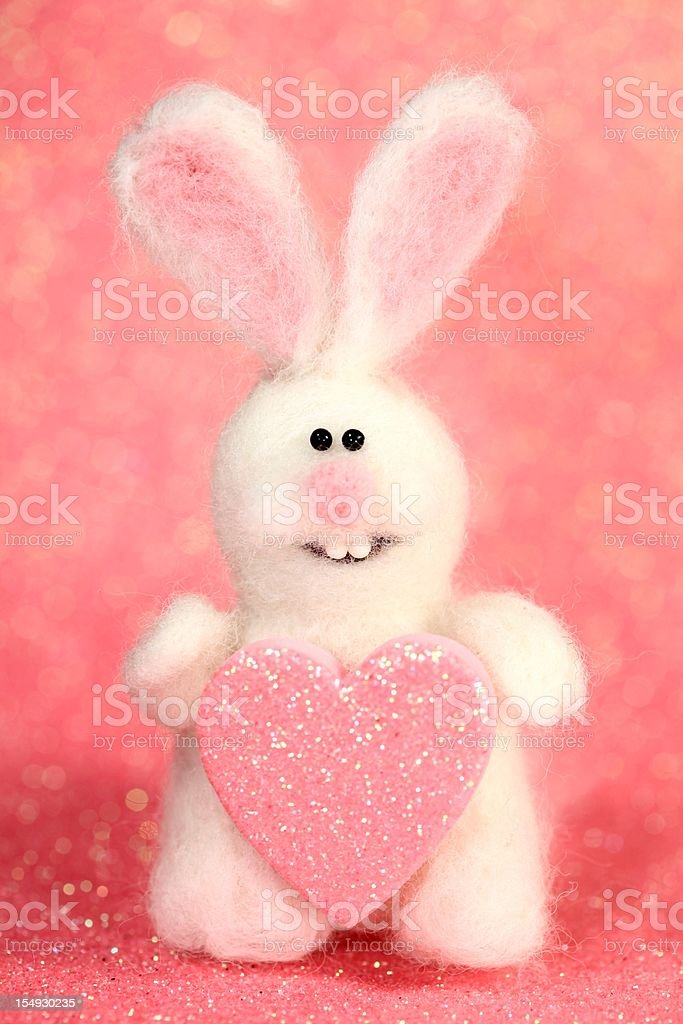 Honeysuckle colored Bunny with heart stock photo