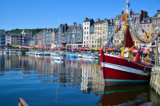 Honfleur, France - Boats This beautiful seaport town is as picturesque as it looks.   Situated in the Calvados region of France (Normandy) Honfleur somehow escaped the ravages of WWII,  and has managed to preserve the traces of a rich historical past.  Often considered the birthplace of Impressionism, and remains on of the most painted scenes in France. normandy stock pictures, royalty-free photos & images
