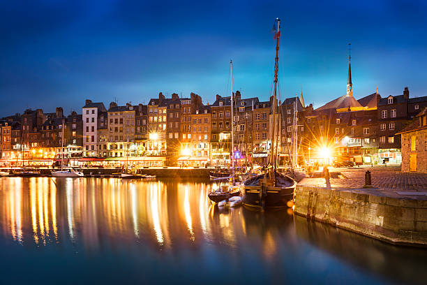 Honfleur, Normany, France Nightscape of the old harbor in Honfleur, France (02) le havre stock pictures, royalty-free photos & images