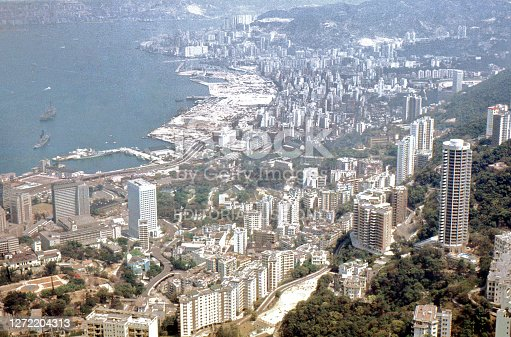 Hong Kong, 1971 View from mid levels at The Peak, with high rise buildings, and looking to harbour, with wharves and ships.