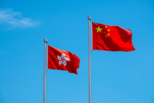 istock Hong Kong And Chinese Flag With Blue Sky 966902692