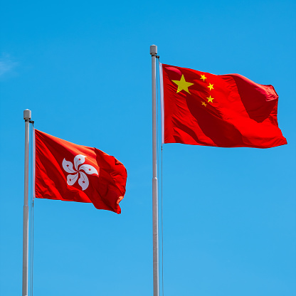 istock Hong Kong And Chinese Flag With Blue Sky 966907586