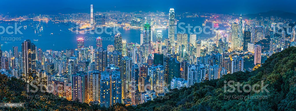 Hong Kong at night iconic panorama over illuminated harbour skyscrapers stock photo