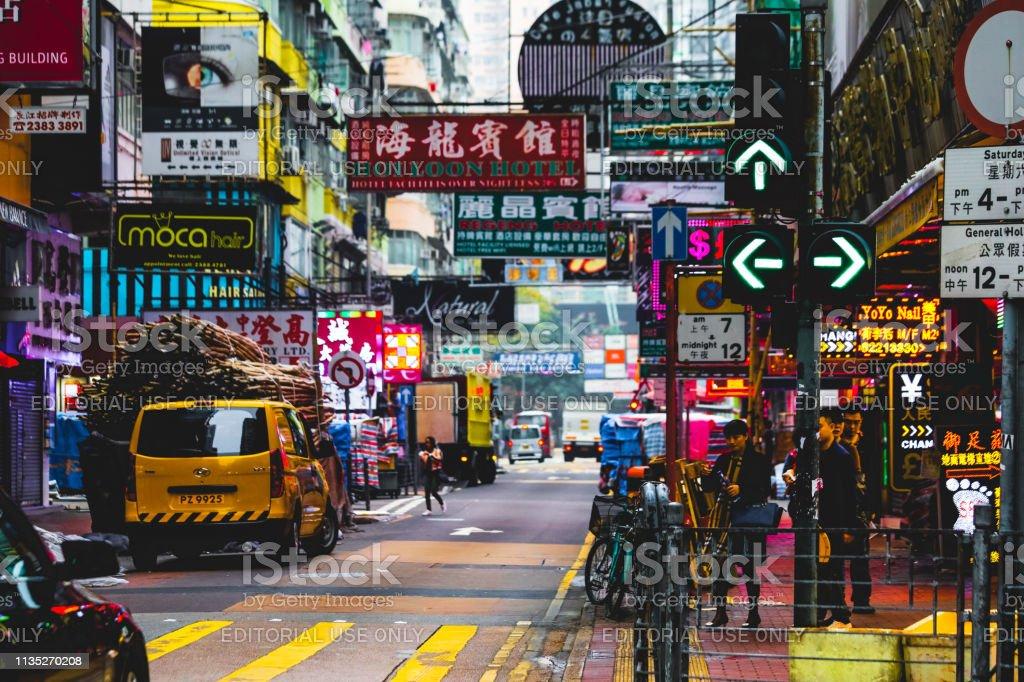 Hong Kong busy street traffic neon crosswalk crowd rush hour...