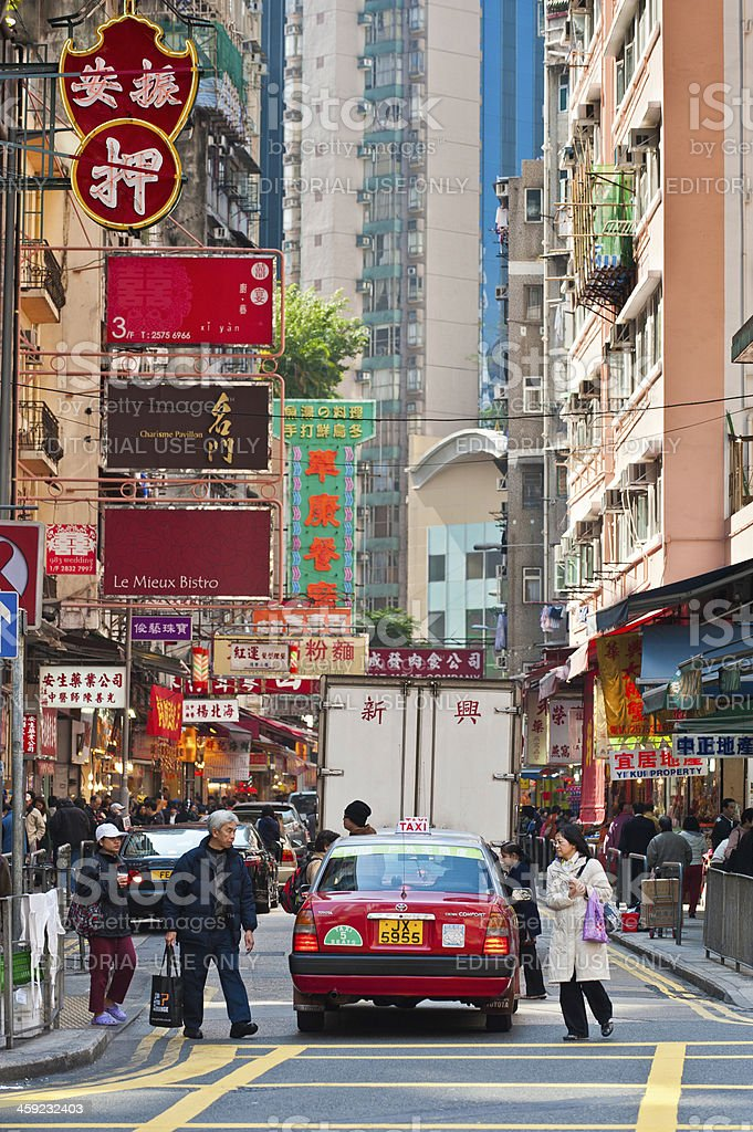Hong Kong busy streets shoppers taxi colorful signs China royalty-free stock photo