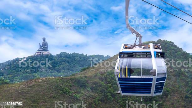 Hong kong cable car over green mountain with giant buddha statue picture id1162369760?b=1&k=6&m=1162369760&s=612x612&h=rzxajyvpqabzpv7iuxxlx7a4nqxeu solow n7yhnaw=