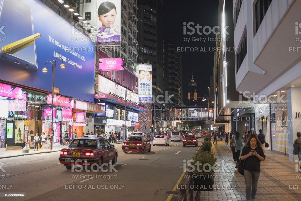 Hong Kong Canton Road, Tsim Sha Tsui at night, there is a luxury brands shopping street in Hong Kong Tsimshatsui, Hongkong - September 7, 2018: Hong Kong Canton Road, Tsim Sha Tsui at night, there is a luxury brands shopping street in Hong Kong Asia Stock Photo