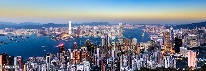 Panoramic View on a clear day of the Hong Kong City Skyline and Victoria Harbour at dusk, China.