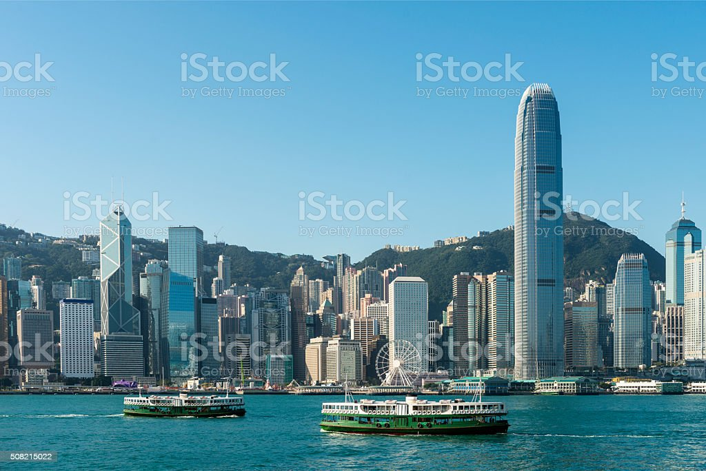Hong Kong City Skyline and Harbour with Ferry, China. stock photo