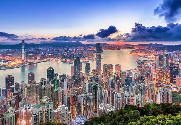 hong kong city view from peak at sunrise - hong kong fotografías e imágenes de stock
