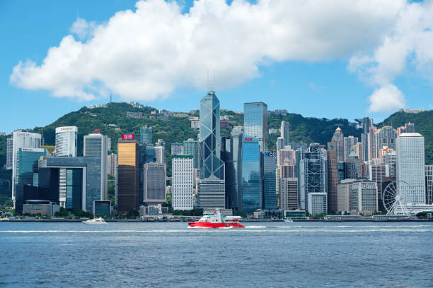 Hong Kong cityscape Hong Kong, China - june 08, 2017: Victoria Harbor and Hong Kong Island Skyline. Hong Kong is one of the most densely populated City. bank of china stock pictures, royalty-free photos & images
