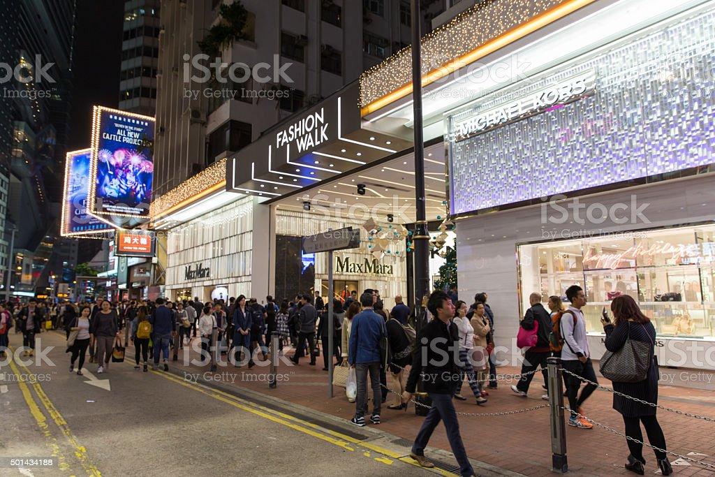 Hong Kong crowded street of shopping district at night stock photo