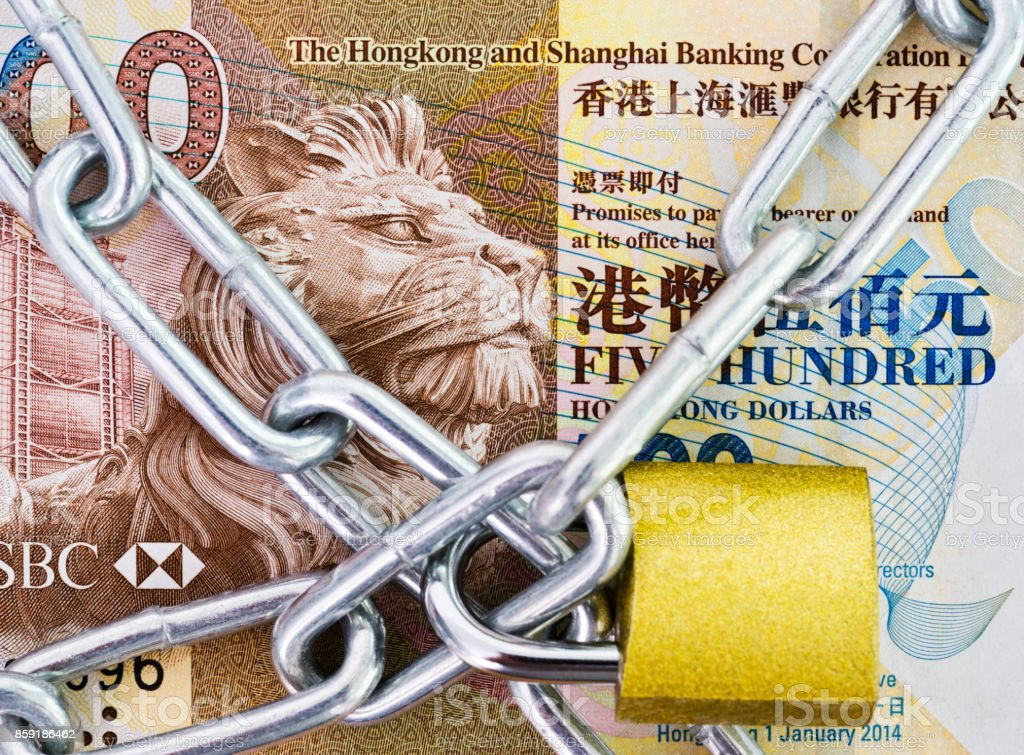 Hong Kong currency with a chain and lock stock photo