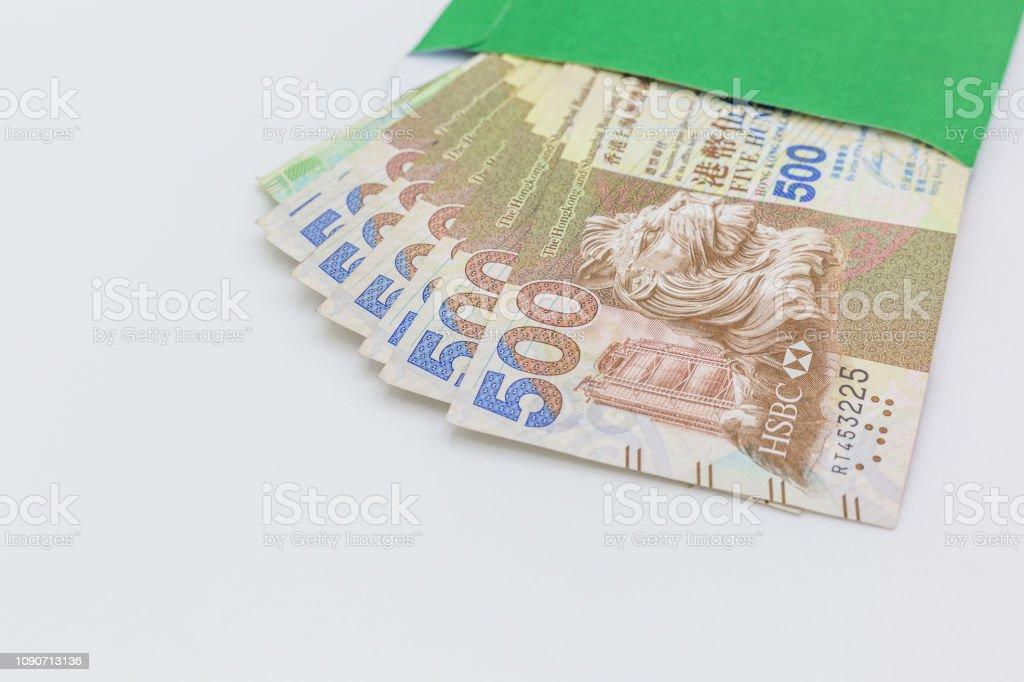Hong Kong Dollar Bank Notes Money In Green Envelope On White