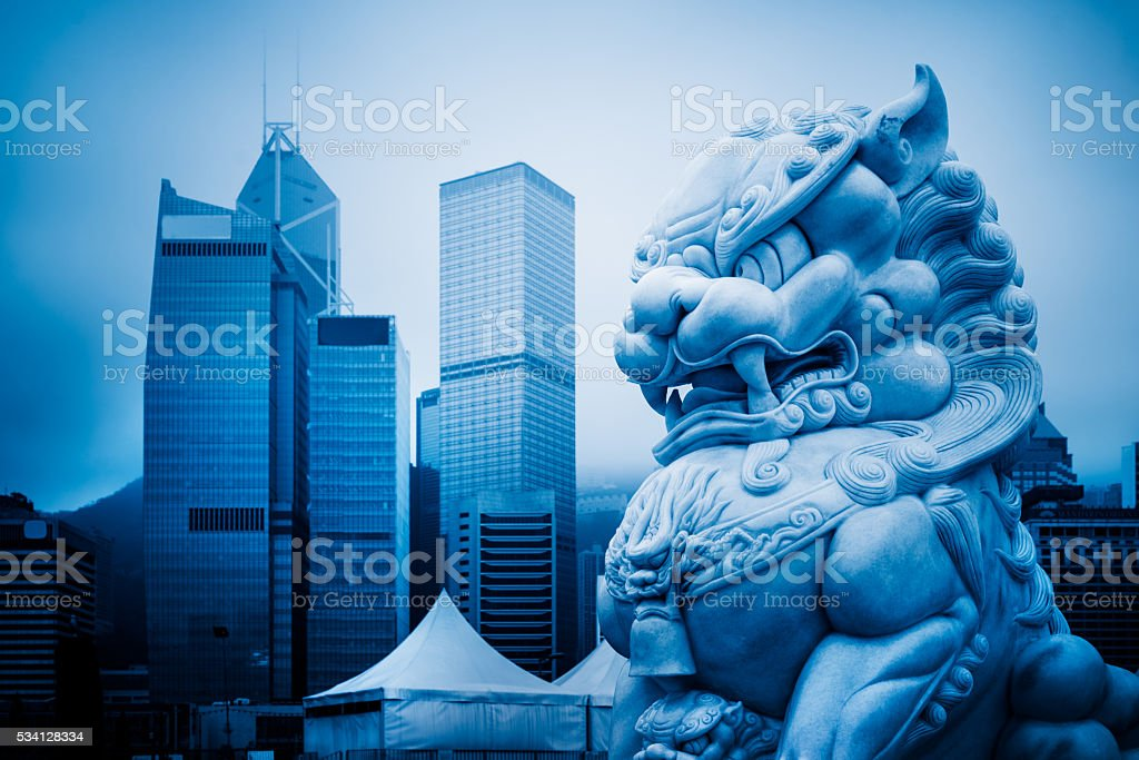 hong kong famous skyscrapers,and stone lion stock photo