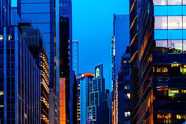 Hong Kong financial district by night. Hong Kong, Hong Kong SAR - May 5, 2014: Banks and other office buildings in financial district by night. hsbc stock pictures, royalty-free photos & images