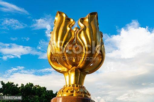 istock Hong Kong Golden Bauhinia Flower statue 1254070446