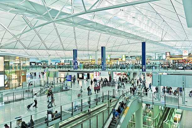 hong kong international airport, china asia - airport terminal stock photos and pictures