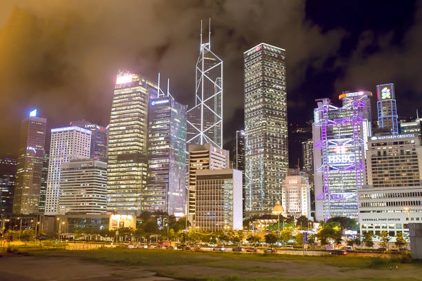 Hong Kong landmark night scene. Central business district  is the commercial and business centre of a Hong Kong Central, Hong Kong - july 14, 2017. Hong Kong landmark night scene. Central business district  is the commercial and business centre of a Hong Kong bank of china stock pictures, royalty-free photos & images