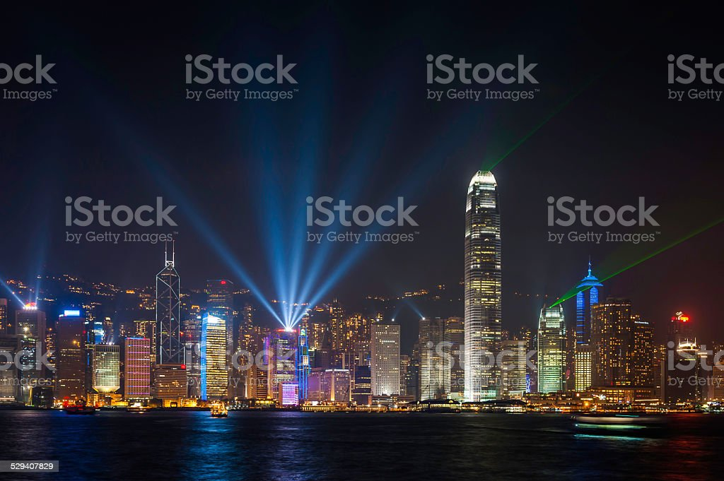 Hong Kong laser light show over futuristic harbour skyscrapers China stock photo