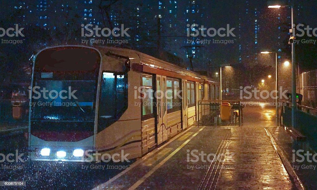 Photo is taken in a Light Rail station in Tuen Mun in a rainy night.