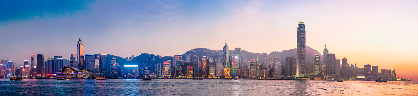 Hong Kong Neon Sunset Iconic Harbour Skyscrapers Illuminated Panorama China Stock Photo - Download Image Now