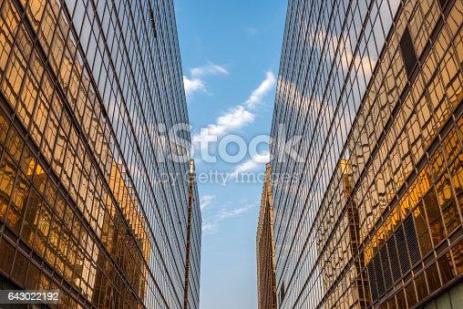 Golden office building in Hong Kong, looking up in between