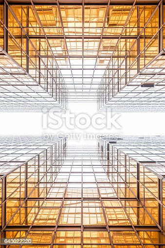 Golden office building in Hong Kong, looking up in between