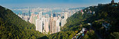 """""""Iconic panoramic vista over the green hillsides and crowded city blocks of Honk Kong Island, the skyscrapers and high rise apartment blocks of Sheung Wan, the Central District and Wan Chai, across the busy harbor to Tsim Sha Tsui in Kowloon and the New Territories beyond, China. ProPhoto RGB profile for maximum color fidelity and gamut."""""""