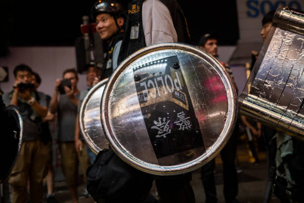 Hong Kong police with riot shields stock photo