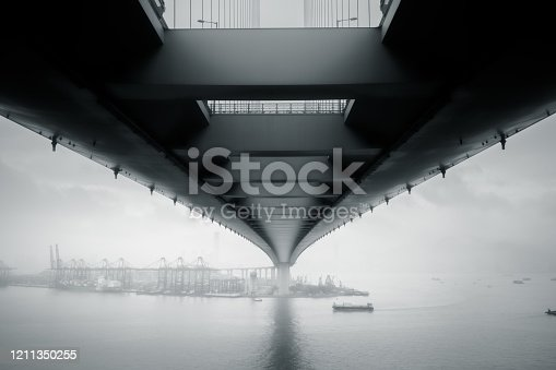 Fog and clouds over Hong Kong port and the Stonecutters Bridge, a high level cable-stayed bridge which spans the Rambler Channel for 1,6 km.