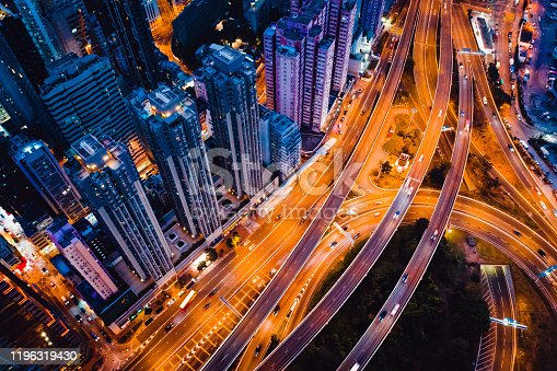 599471112 istock photo Hong Kong skyline and busy highway system at night. 1196319430