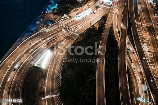 599471112 istock photo Hong Kong skyline and busy highway system at night. 1196319433
