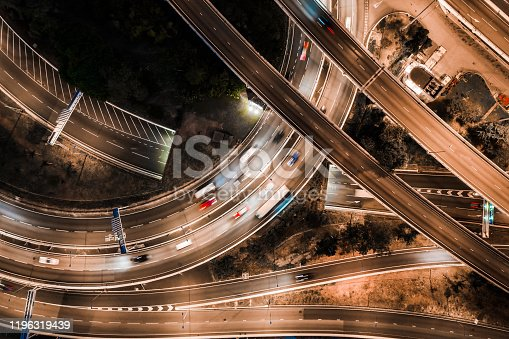 599471112 istock photo Hong Kong skyline and busy highway system at night. 1196319439