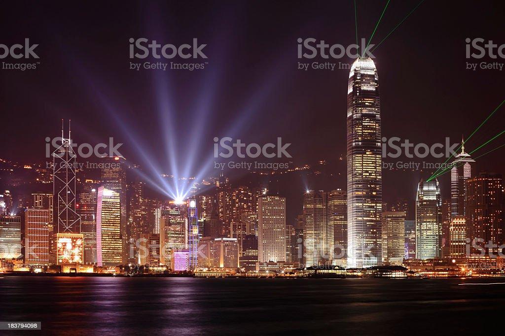 Hong Kong skyline at night with bright beams of light royalty-free stock photo